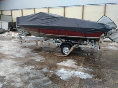 <Хранение лодок зимой на прицепе.